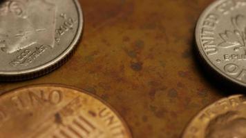 roterend voorraadbeeldschot van Amerikaanse monetaire muntstukken - geld 0324