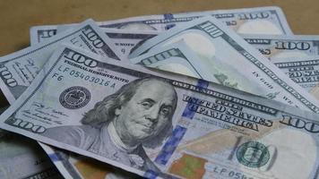 Rotating stock footage shot of $100 bills - MONEY 0142