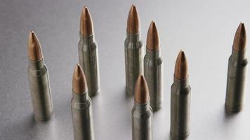 Cinematic rotating shot of bullets on a metallic surface - BULLETS 001