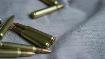 Cinematic rotating shot of bullets on a fabric surface - BULLETS 102