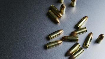 Cinematic rotating shot of bullets on a metallic surface - BULLETS 045