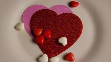 Rotating stock footage shot of Valentines decorations and candies - VALENTINES 0096