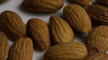 Cinematic, rotating shot of almonds on a white surface - ALMONDS 009