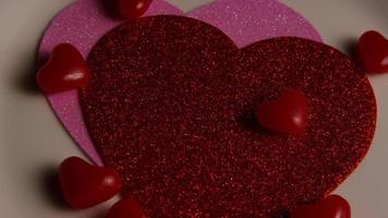Rotating stock footage shot of Valentines decorations and candies - VALENTINES 0110 video
