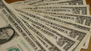 foto rotativa de dinheiro americano (moeda) - dinheiro 550