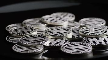 Rotating shot of Bitcoins (digital cryptocurrency) - BITCOIN LITECOIN 433