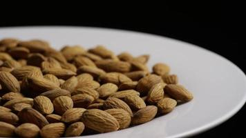 Cinematic, rotating shot of almonds on a white surface - ALMONDS 034