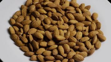 Cinematic, rotating shot of almonds on a white surface - ALMONDS 022