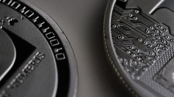 Rotating shot of Litecoin Bitcoins (digital cryptocurrency) - BITCOIN LITECOIN 0121 video