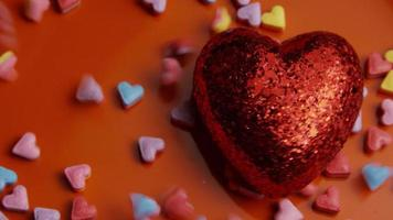 Rotating stock footage shot of Valentines decorations and candies - VALENTINES 0081
