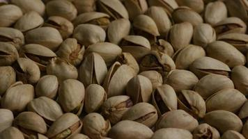 Cinematic, rotating shot of pistachios on a white surface - PISTACHIOS 014
