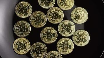 Rotating shot of Bitcoins (digital cryptocurrency) - BITCOIN 0456