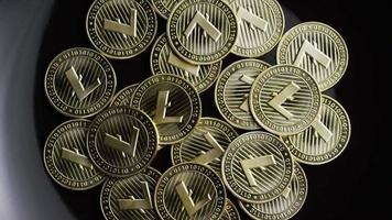 Rotating shot of Bitcoins (digital cryptocurrency) - BITCOIN LITECOIN 225
