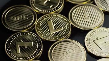 Rotating shot of Bitcoins (digital cryptocurrency) - BITCOIN LITECOIN 282