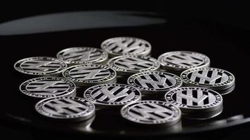 Rotating shot of Bitcoins (digital cryptocurrency) - BITCOIN LITECOIN 403