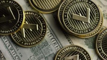Rotating shot of Bitcoins (digital cryptocurrency) - BITCOIN LITECOIN 566
