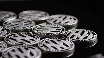 Rotating shot of Bitcoins (digital cryptocurrency) - BITCOIN LITECOIN 404