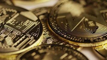 Rotating shot of Bitcoins (digital cryptocurrency) - BITCOIN MONERO 112