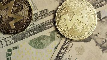 Rotating shot of Bitcoins (digital cryptocurrency) - BITCOIN MONERO 160
