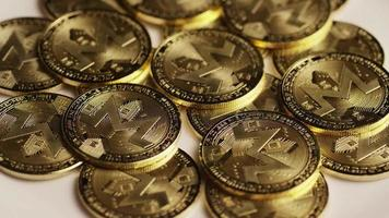 Rotating shot of Bitcoins (digital cryptocurrency) - BITCOIN MONERO 061