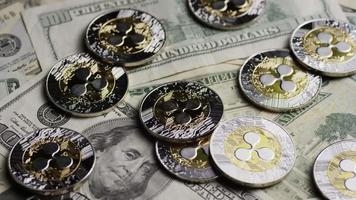 Rotating shot of Bitcoins (digital cryptocurrency) - BITCOIN RIPPLE 0235 video