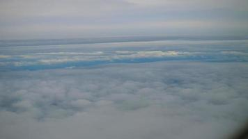 Aerial view of clouds from an airplane window
