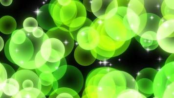 grüne funkelnde kreisförmige Partikel steigen auf