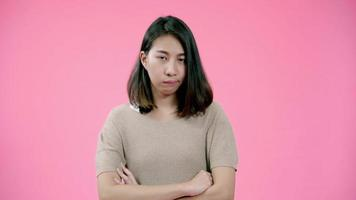 Asian woman angry serious face in casual clothing looking seriously at camera.