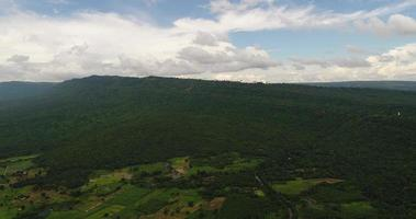 Aerial view wide shot point of view mountain with lush trees