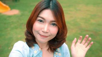 Attractive beautiful happy Asian women blogger using smartphone for selfie.