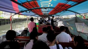 Passengers inside the express boat in Bangkok, Thailand