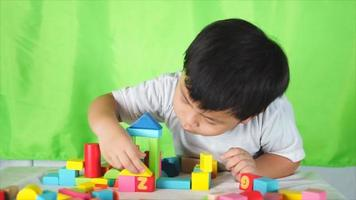 Cute Boy Playing With Wooden Blocks