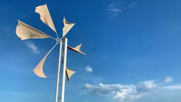 Wind turbine or windmill with blue sky background video