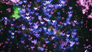 pequenos corações caindo e luzes em forma de coração video