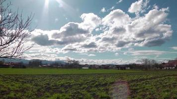 View of a countryside with filed and clouds video