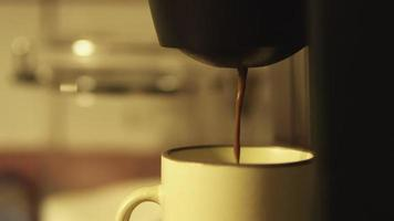 Coffee pours in slow motion video