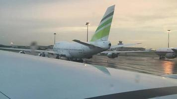 View from a taxiing plane at an airport on a rainy day