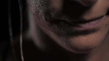 Close up of woman's mouth as she exerts herself while coming out