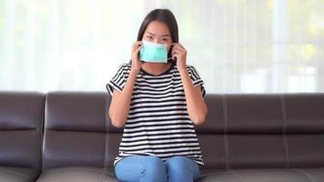 Young Asian woman putting on a medical mask  video