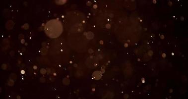 partículas de bokeh dorado movidas por el viento con movimientos aleatorios y giros en 4k video