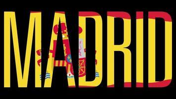 Flagge Spaniens mit Typmaske im Vordergrund. Madrid.