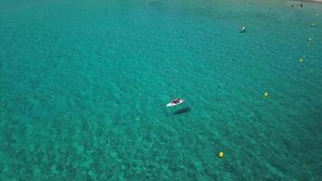 Flying over a paddle board in the bay in 4K video