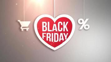 sinal de coração preto sexta-feira pendurado em um barbante com carrinho de compras e ícone de porcentagem