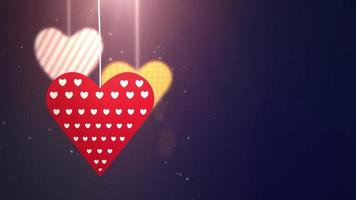 paper valentine hearts falling down hanging on string blue background video