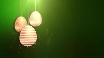 felices pascuas de pascua dorados colgando huevos de pascua animados con fondo verde.