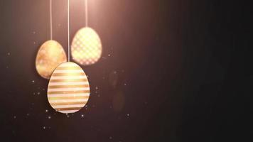 felices pascuas de pascua dorados colgantes de huevos de pascua animados con fondo negro.
