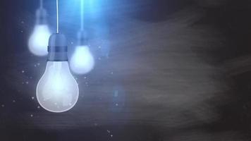 lâmpadas incandescentes caindo penduradas no fundo cinza
