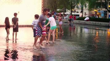 Childs Walking In The Crown Fountain In Chicago