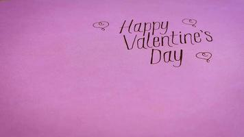 Happy Valentines Lettering With Gifts On Pink Background