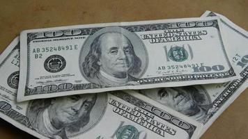 Rotating stock footage shot of $100 bills - MONEY 0147
